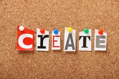 The word Create on a cork board
